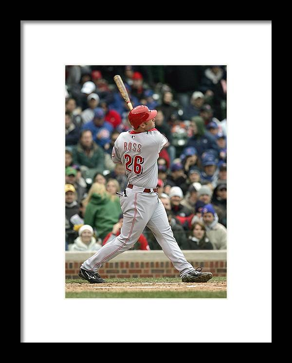 Motion Framed Print featuring the photograph Cincinnati Reds v Chicago Cubs by Jonathan Daniel