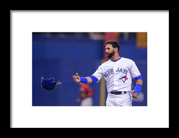 Headwear Framed Print featuring the photograph Cincinnati Reds V. Toronto Blue Jays by Vincent Ethier