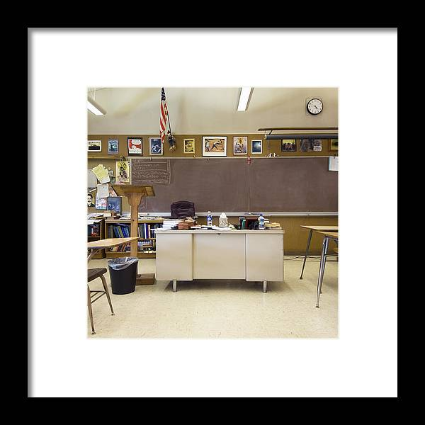 Classroom With Teacher S Desk In Middle Of Room Framed Print