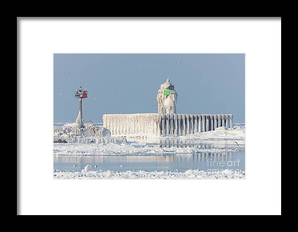 Clarence Holmes Framed Print featuring the photograph Cleveland Harbor East Pierhead Light by Clarence Holmes