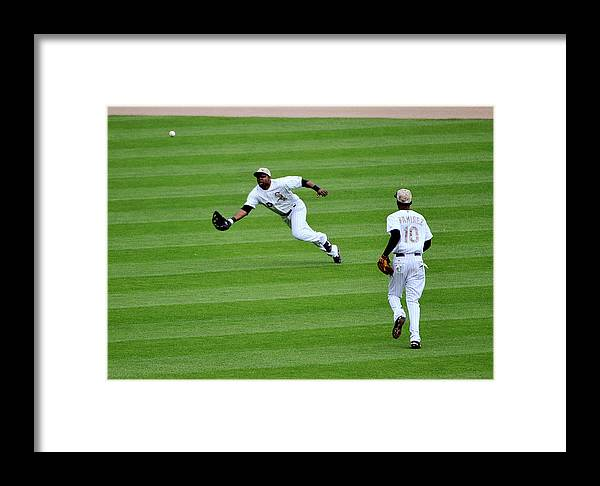 Alejandro De Aza Framed Print featuring the photograph Cleveland Indians V Chicago White Sox by David Banks