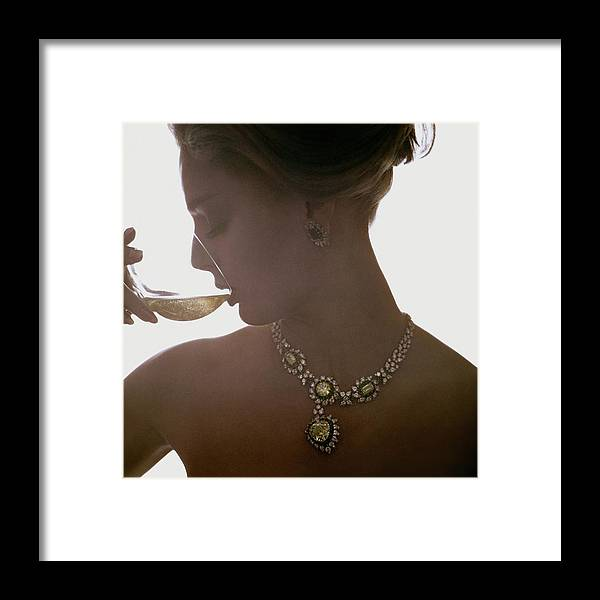 Jewelry Framed Print featuring the photograph Close Up Of A Young Woman Wearing Jewelry by Bert Stern