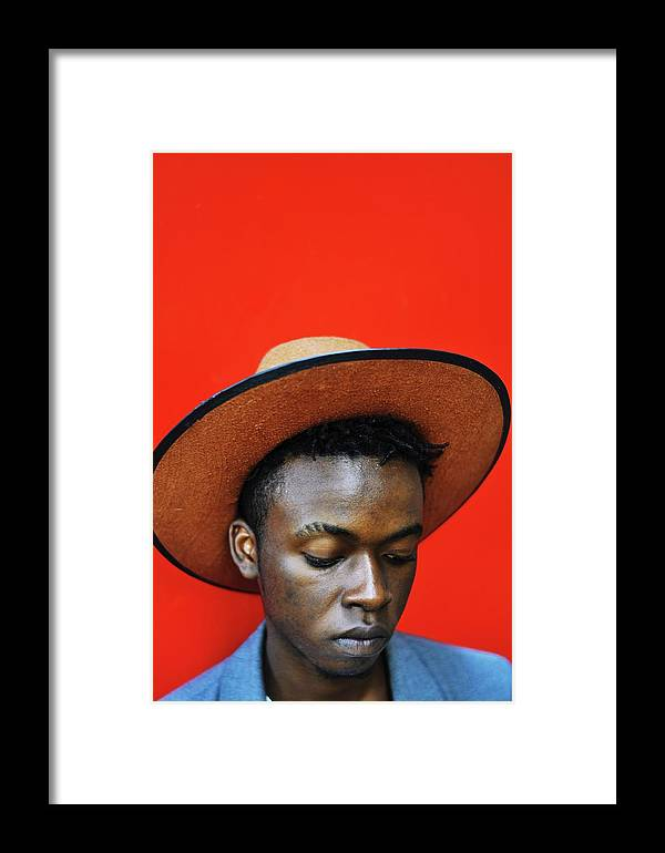 Young Men Framed Print featuring the photograph Close-up Of Man Wearing Hat Against Red by Samson Wamalwa / Eyeem