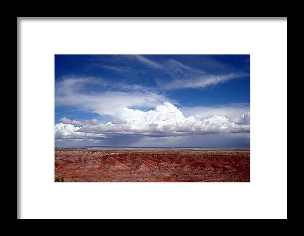 Badlands Framed Print featuring the photograph Clouds Over The Badlands by Susan Woodward