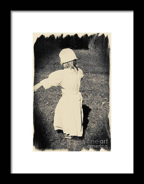 Photograph Framed Print featuring the photograph Colonial Girl Playing by Jan Tyler