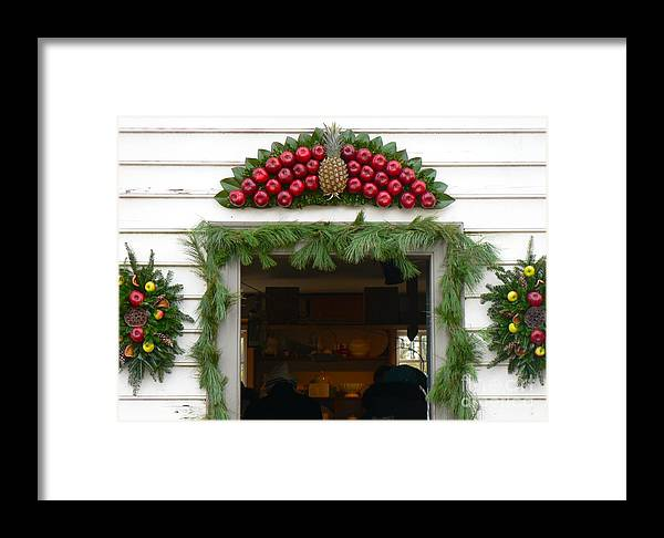 Decorations Framed Print featuring the photograph Colonial Williamsburg Yuletide Decorations by Jean Wright