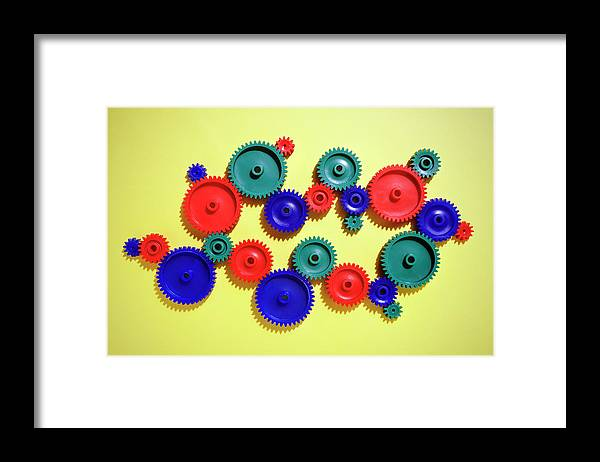 Working Framed Print featuring the photograph Colored Gears by Joseph Clark
