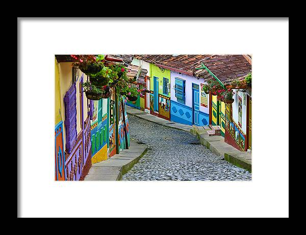 Built Structure Framed Print featuring the photograph colourful architecture in Guatape by Barna Tanko