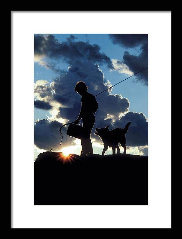 Boy Framed Print featuring the photograph Coming Home by John Jacquemain