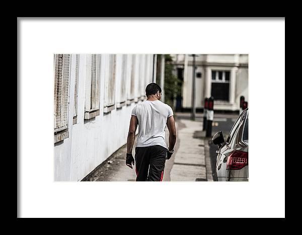 Framed Print featuring the photograph Confident Man by YAWAT DJAMEN William
