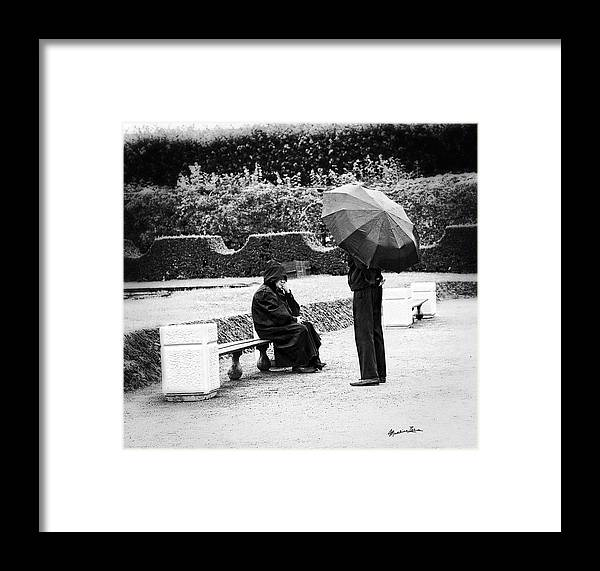 Men Framed Print featuring the photograph Conversation In The Rain by Madeline Ellis