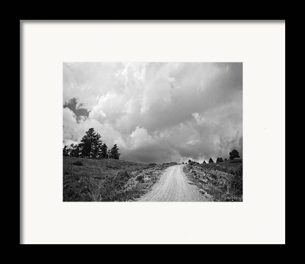 Black And White Framed Print featuring the photograph Country Road With Stormy Sky In Black And White by Julie Magers Soulen
