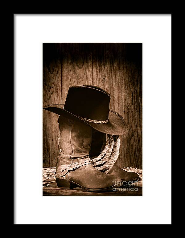 Boots Framed Print featuring the photograph Cowboy Hat And Boots by Olivier  Le Queinec b898f38fdaf1