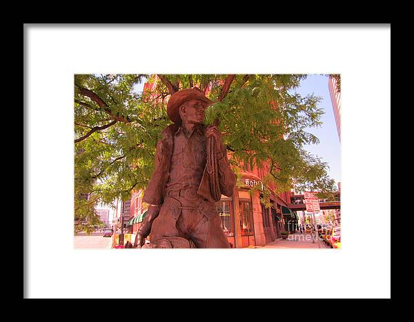 Western Sculpture Art Framed Print featuring the photograph Cowboy Statue In Front Of The Brown Palace Hotel In Denver by John Malone