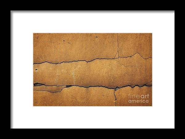 Cracked Yellow Wall Framed Print featuring the photograph Cracked Yellow Wall by Jolanta Meskauskiene