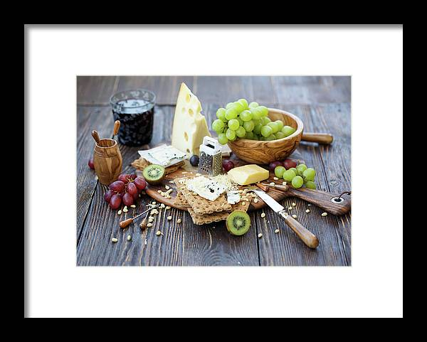 Breakfast Framed Print featuring the photograph Crackers With Cheese And Fruits by Julia Khusainova