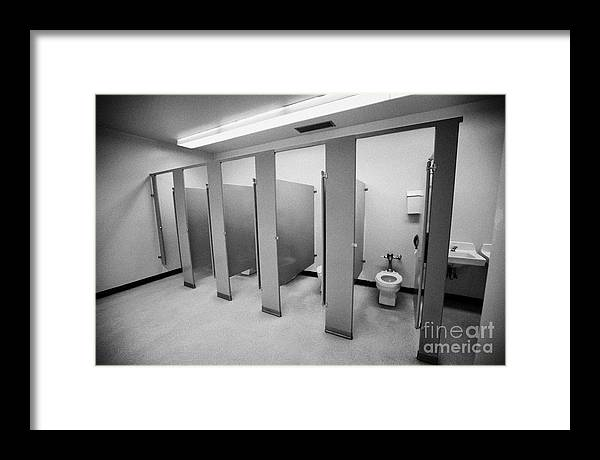 toilet framed print featuring the photograph cubicle toilet stalls in womens bathroom in a high school - Womens Bathroom
