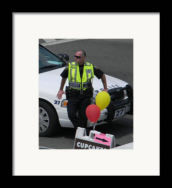 Policeman Framed Print featuring the photograph Cupcake And Balloon Checkpoint by Christy Usilton