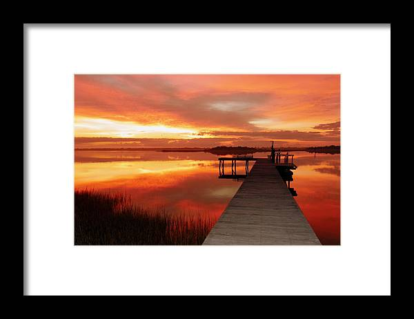 Orange Waterscapes Framed Print featuring the photograph Dawn Of New Year by Karen Wiles
