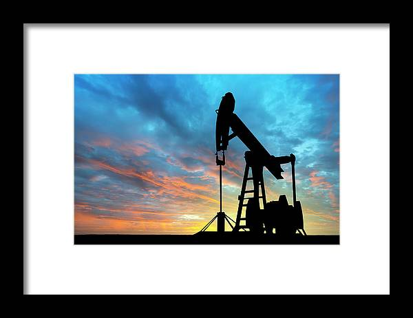 Shadow Framed Print featuring the photograph Dawn Over Petroleum Pump by Grafissimo
