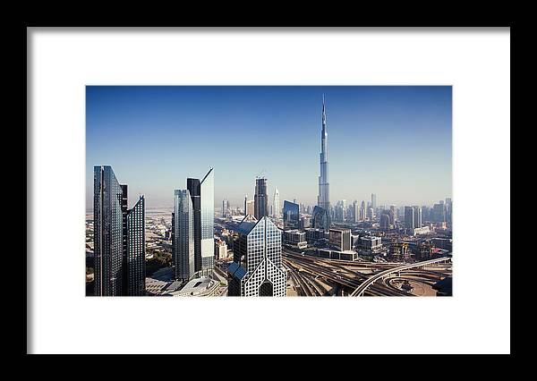 Downtown District Framed Print featuring the photograph Dbuai Sky Line With Traffic Junction by Tempura
