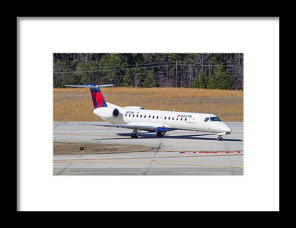 Framed Print featuring the photograph Delta Airlines ERJ-145LR by Richard Jack-James