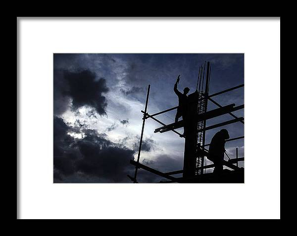 Worker Framed Print featuring the photograph Work Hard by Miel Paculanang