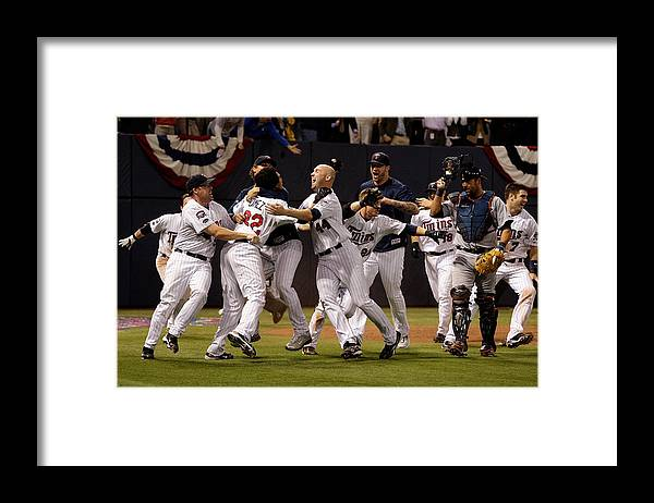 Hubert H. Humphrey Metrodome Framed Print featuring the photograph Detroit Tigers v Minnesota Twins by Jamie Squire