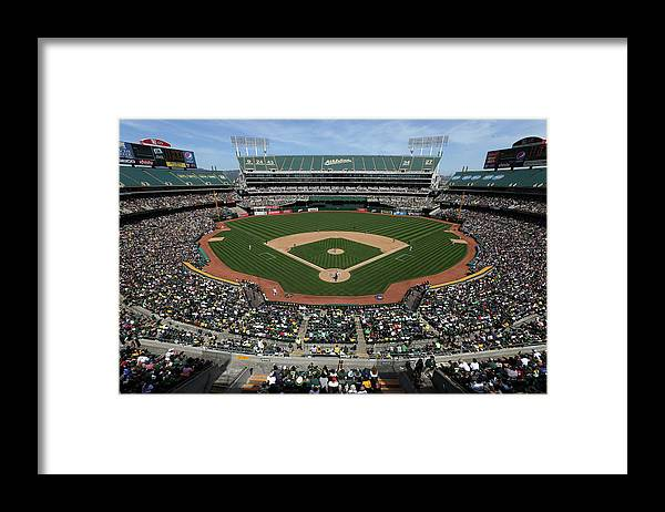 American League Baseball Framed Print featuring the photograph Detroit Tigers Vs. Oakland Athletics by Brad Mangin