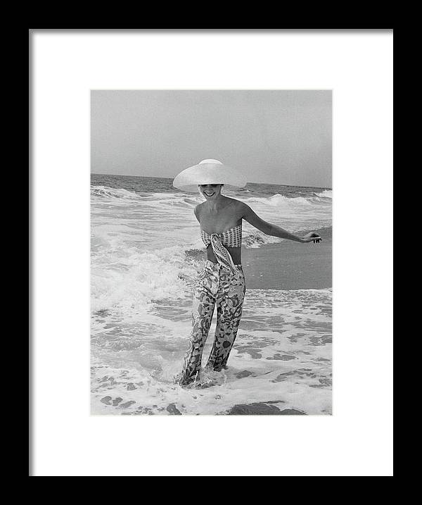 Fashion Framed Print featuring the photograph Diana Ewing Playing At A Beach by John Shannon