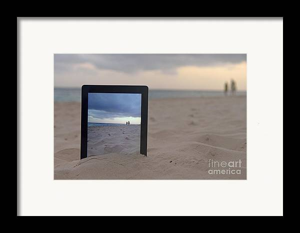 People Framed Print featuring the photograph Digital Tablet In Sand On Beach by Sami Sarkis