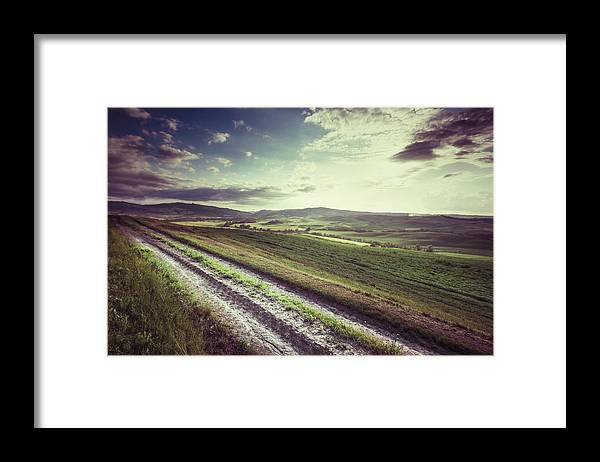 Steppe Framed Print featuring the photograph Dirt Track In Tuscany by Xavierarnau