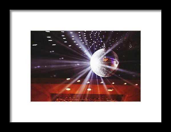 Hanging Framed Print featuring the photograph Disco Ball At Illuminated Nightclub by Shaun Wang / Eyeem