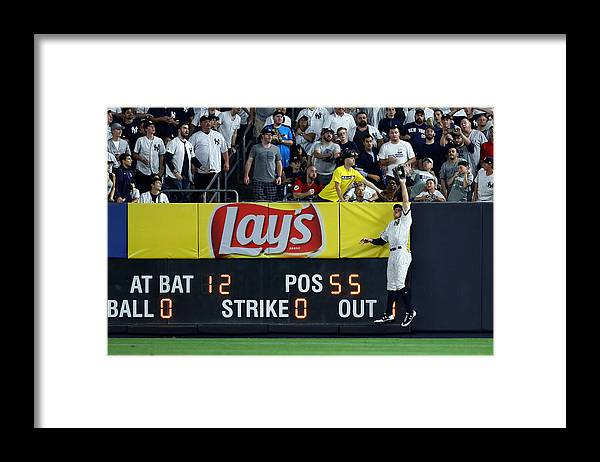 People Framed Print featuring the photograph Divisional Round - Cleveland Indians v New York Yankees - Game Three by Al Bello