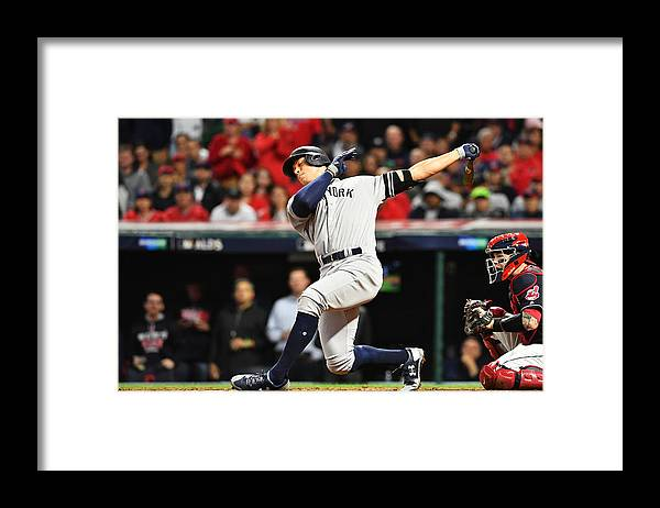 People Framed Print featuring the photograph Divisional Round - New York Yankees v Cleveland Indians - Game Five by Jason Miller