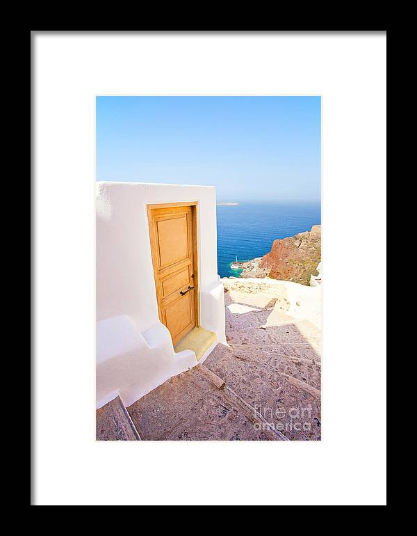 Santorini Framed Print featuring the photograph Door Suddenly by Aiolos Greek Collections