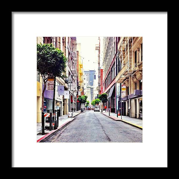 Street Scene Framed Print featuring the photograph Downtown by Julie Gebhardt