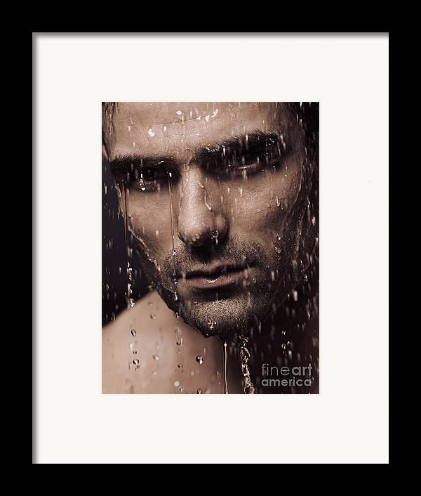 Man Framed Print featuring the photograph Dramatic Portrait Of Man Face With Water Pouring Over It by Oleksiy Maksymenko