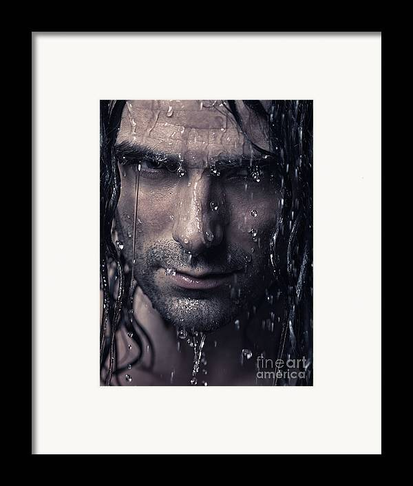 Man Framed Print featuring the photograph Dramatic Portrait Of Man Wet Face With Long Hair by Oleksiy Maksymenko