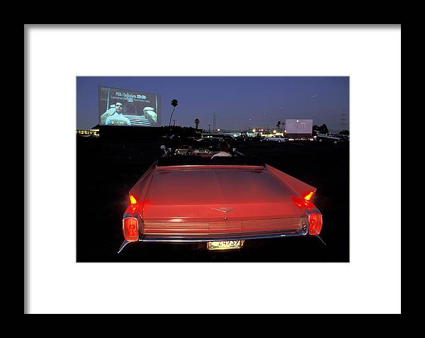 Pink Cadillac Framed Print featuring the photograph Drive In by Christian Heeb