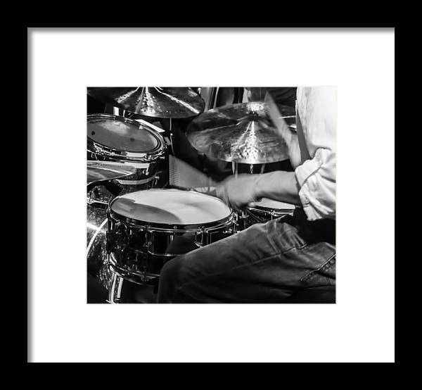 Drum Set Framed Print featuring the photograph Drummer at work by Photographic Arts And Design Studio