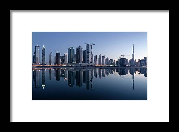 Tranquility Framed Print featuring the photograph Dubai Business Bay Skyline With by Spreephoto.de