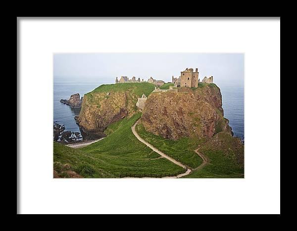 Abandoned Framed Print featuring the photograph Dunnottar Castle Scotland by Georgi Djadjarov