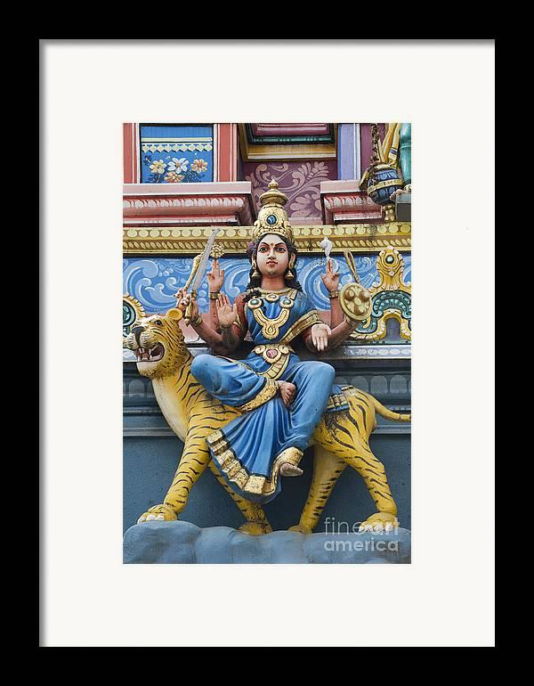 Durga Framed Print featuring the photograph Durga Statue On Hindu Gopuram by Tim Gainey