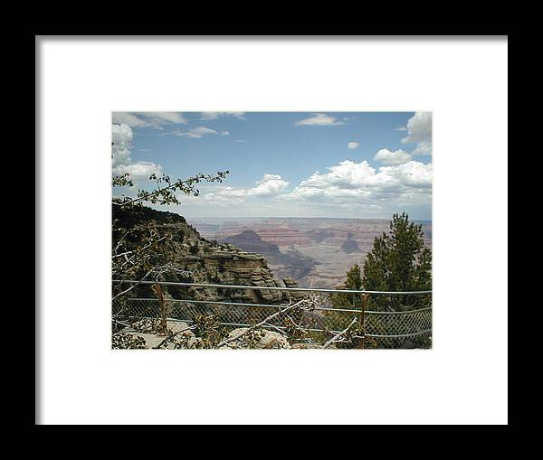 Fence Framed Print featuring the photograph Edge Of Canyon by Minnie Davis