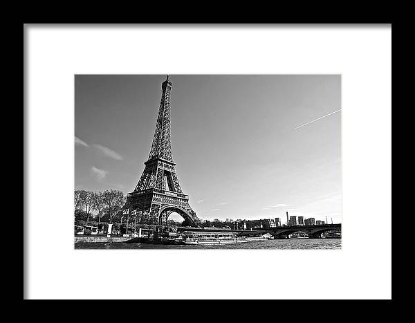 Paris Framed Print featuring the photograph Eiffel Tower And The Seine by Galexa Ch