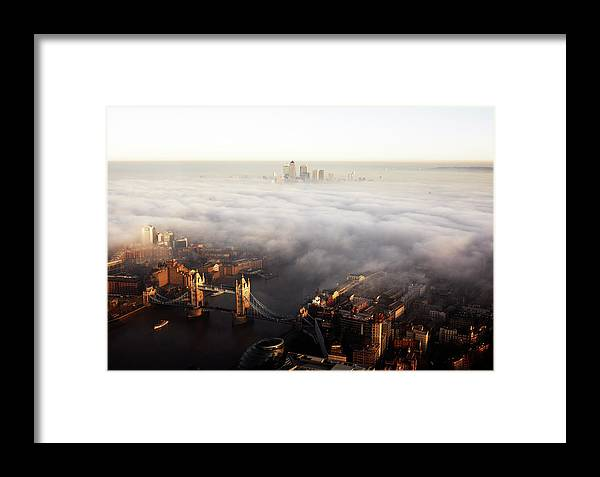 Gla Building Framed Print featuring the photograph Elevated View Over London Shrouded In by Gary Yeowell