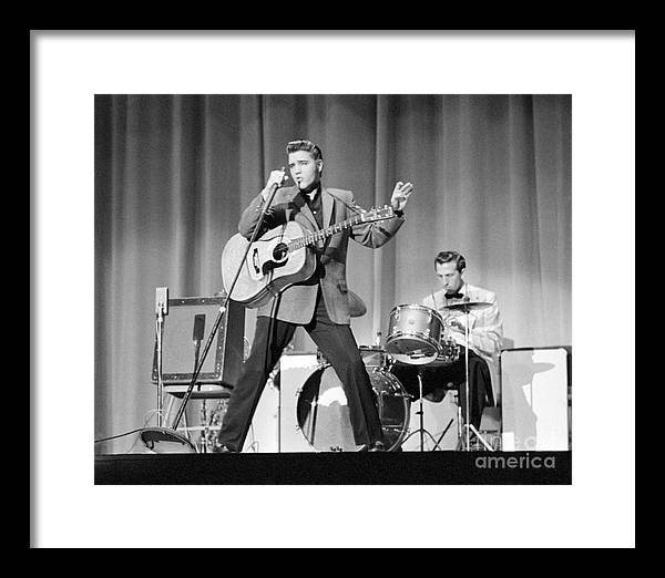 Elvis Presley Framed Print featuring the photograph Elvis Presley and D.J. Fontana performing in 1956 by The Harrington Collection