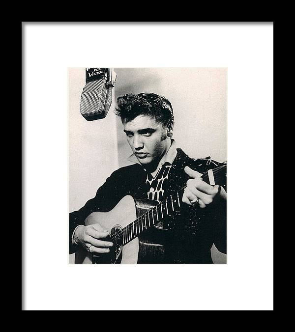 Classic Framed Print featuring the photograph Elvis Presley Plays And Sings Into Old Microphone by Retro Images Archive