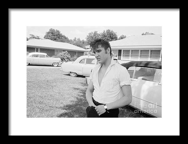 Elvis Presley Framed Print featuring the photograph Elvis Presley with his Cadillacs by The Harrington Collection